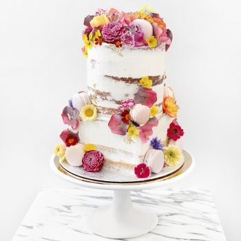 Wedding cake topped with edible flowers and macarons - Colour Pop Cakes