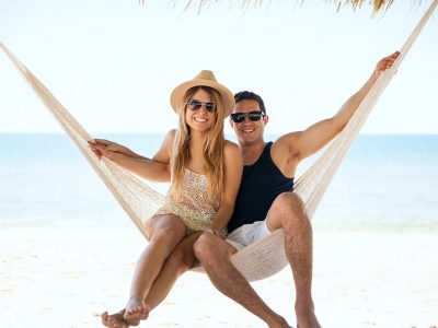 Honeymoon budgetBeautiful couple relaxing in a hammock