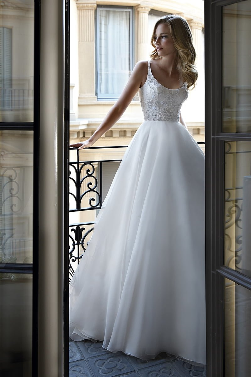 glamorous wedding dresses Chrissy full-skirted dress with lace camisole top, £2,999, Caroline Castigliano