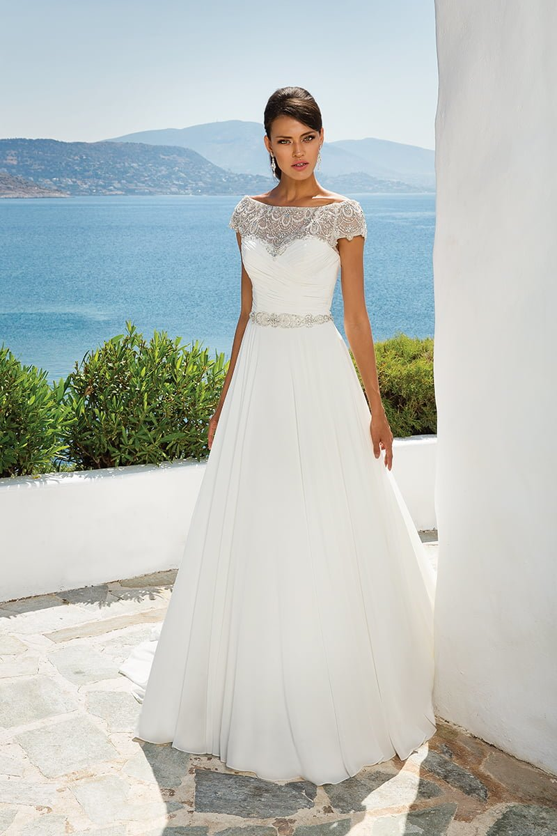 Chiffon ballgown with beaded neckline, Style 8799, £1,660, Justin Alexander - Seaside Treasures