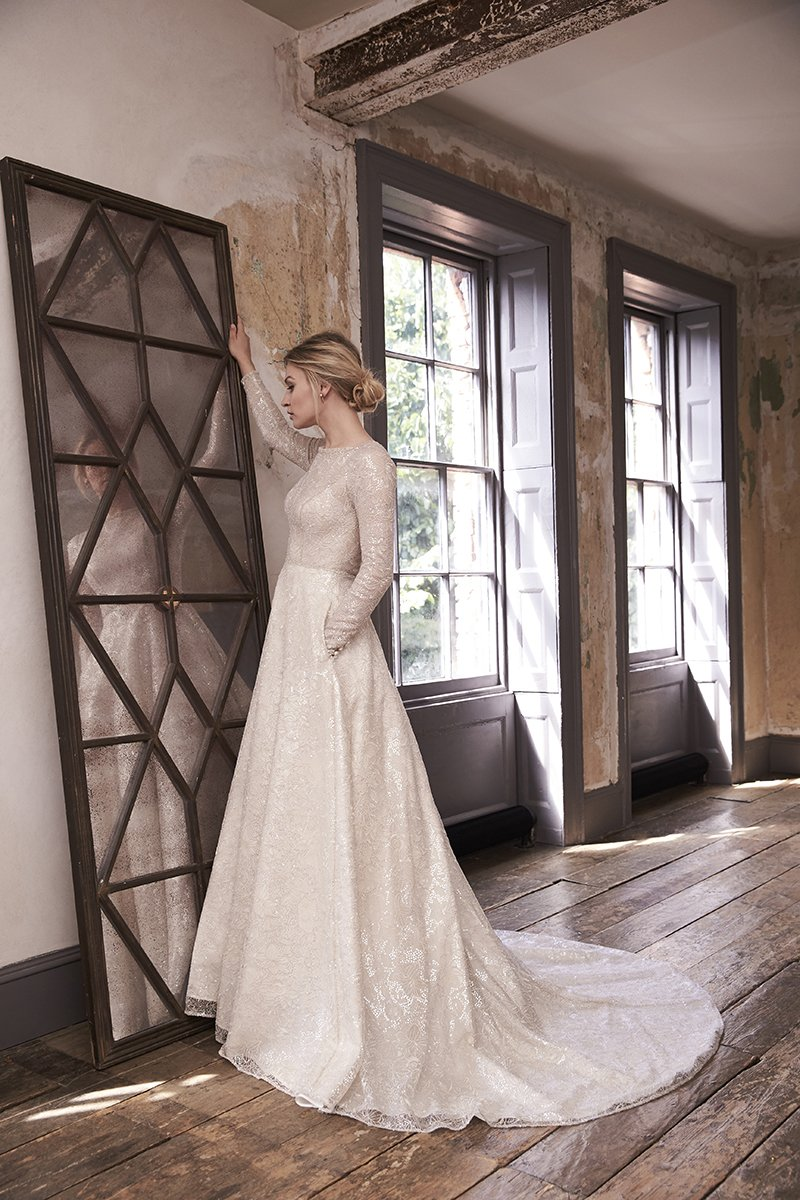 glamorous wedding dresses Sequinned tulle Ivana dress with key-hole back and full-length sleeves, £3,195, Sassi Holford