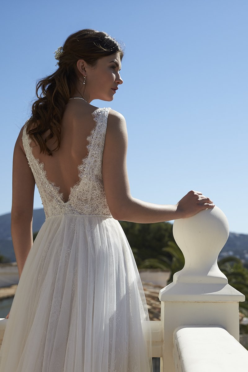 Tulle and lace low-back dress with sparkling bodice, Style PC7219, £840, Phil Collins Bridal