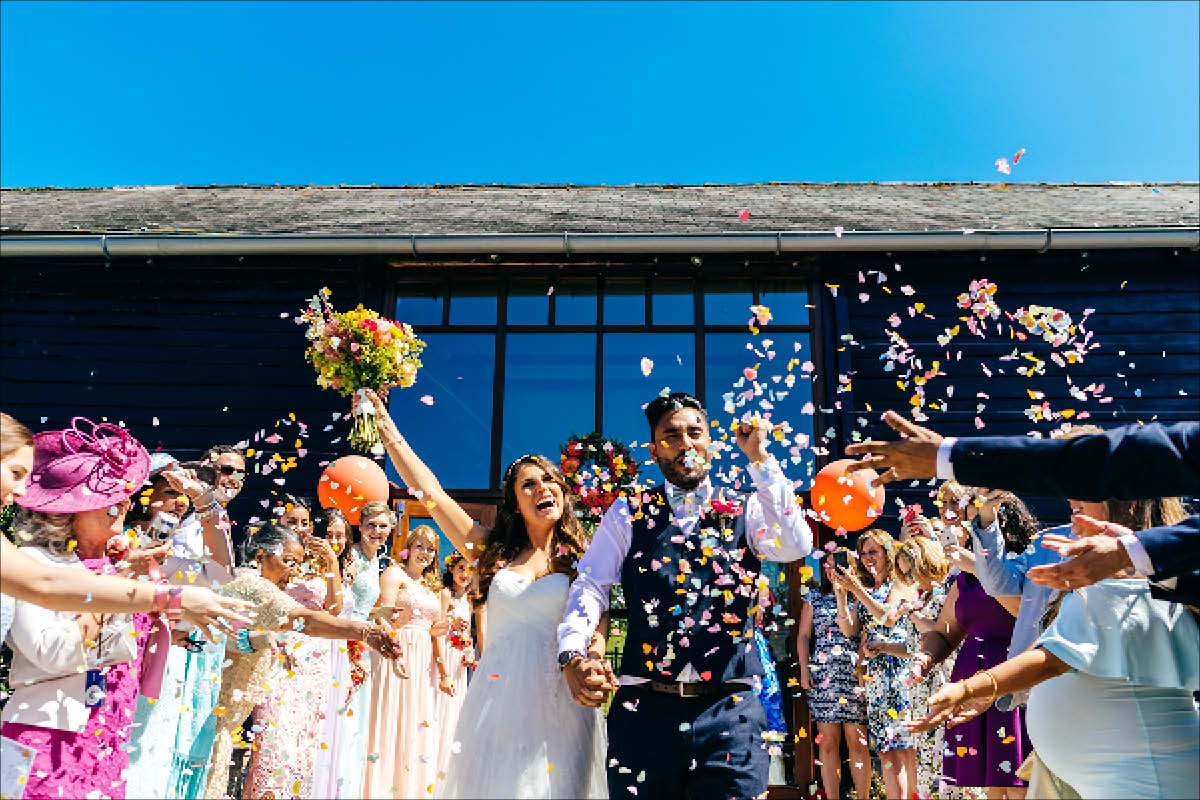 Colourful wedding Upwaltham Barns West Sussex Raye and Robin wedding