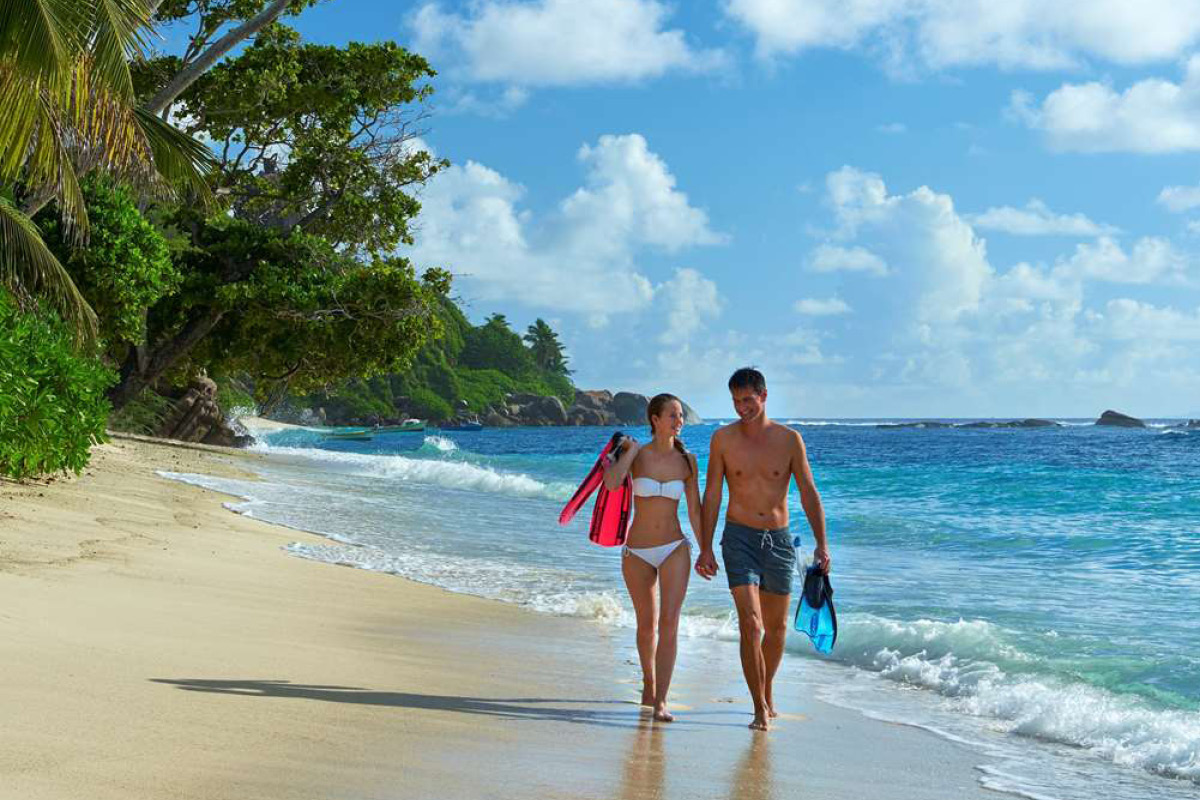 Hilton Seychelles Labriz couple on beach