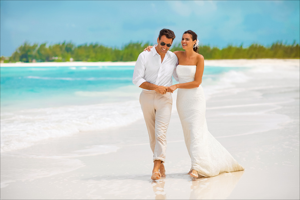 Sandals Emerald Bay Bahamas couple on beach