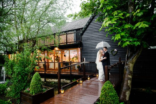 Old Brook Barn Essex couple in the rain